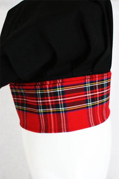 black hat with red tartan trim